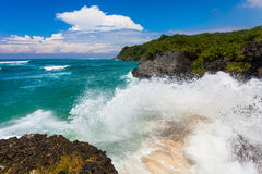 The waves breaking on rock, forming a spray Royalty Free Stock Images