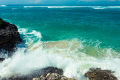 The waves breaking on rock, forming a spray Royalty Free Stock Photography