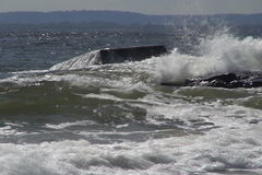 Waves breaking on rock stock video footage