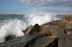 Waves breaking on rocks Stock Image