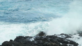 Waves breaking on the rocks stock video footage