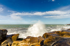 Waves breaking on the rocks on a beach. In Mar del Plata, Argentina Stock Image