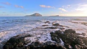 Waves breaking on rocks close to Macapuu beach, Oahu, Hawaii stock footage