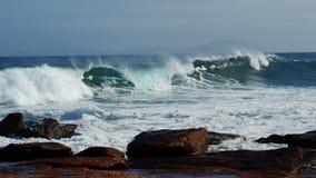 Waves breaking. On rocks on the coast of Western Australia Stock Photos
