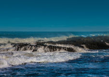 Waves breaking at rocks of the Indian Ocean at the Wild Coast of Royalty Free Stock Image