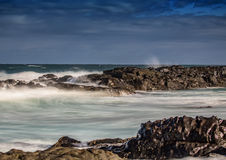 Waves breaking at rocks of the Indian Ocean at the Wild Coast of Stock Images