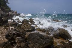 Waves breaking on rocks royalty free stock image