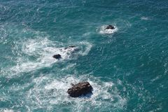 Waves breaking on rocks in sea. In Cabo da Roca, Portugal Stock Images