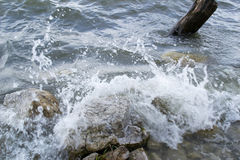 Waves breaking rocks Stock Images