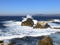Waves breaking on a rocky beach. Waves breaking on the rocky coastline of Point Lobos Natural Reservation, California. U.S.A Royalty Free Stock Images