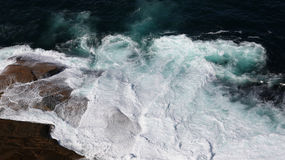 Waves breaking on rocky coast Stock Photo