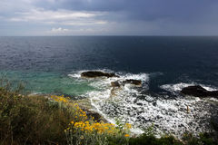 Waves breaking on rocky coast Stock Image