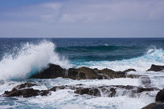 Waves breaking at the rocky coast of La Palma Stock Photo