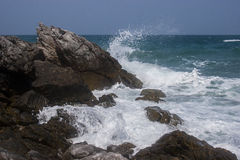 Waves breaking on rocky coast royalty free stock photos