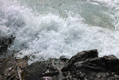 Waves breaking at rocky coast Royalty Free Stock Image
