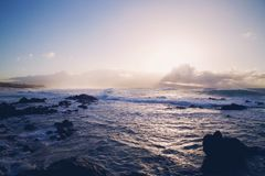 Waves breaking on rocky coastline Royalty Free Stock Images