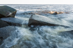 Waves breaking on rocky shore Stock Image