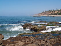 Waves breaking on rocky shore. Scenic view of waves breaking on rocky shoreline, California, U.S.A Royalty Free Stock Photography