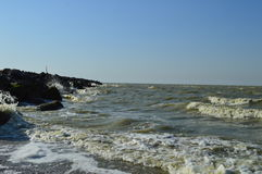 Waves breaking on rocky shore Stock Photography