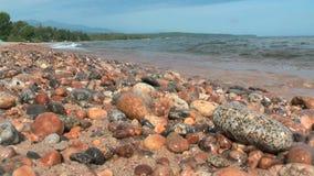 Waves breaking on rocky shore stock video