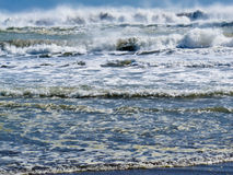 Waves breaking and rolling on beach background Royalty Free Stock Photography