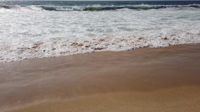 Waves breaking on sand. In a beach stock footage