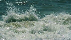 Waves breaking on a seashore stock video