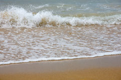 Waves breaking on shore Stock Photo