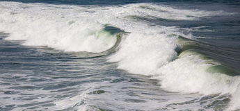 Waves breaking on the shore Stock Photos