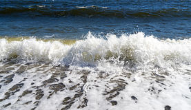Waves breaking on shore in Penobscot Bay, Maine. View of waves breaking on the shore on Penobscot bay in Searsport Maine in the early spring Stock Photography