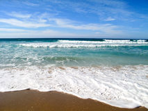Waves breaking on shore of the sea Stock Photos