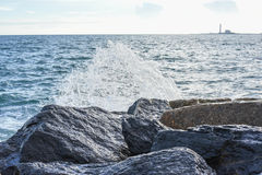 Waves breaking on the shore with sea foam. The waves breaking on the shore with sea foam Stock Images