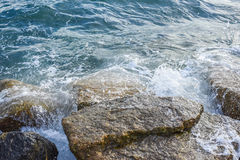 Waves breaking on the shore with sea foam. The waves breaking on the shore with sea foam Royalty Free Stock Image