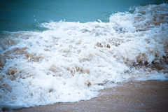 Waves breaking on the shore and transformed into a foam. Selecti Stock Images