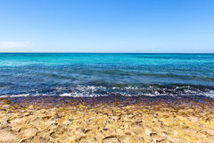 Waves breaking on shore of tropical island. Gentle waves on the shore of a tropical island in the Pacific Ocean. Deep and vibrant blue ocean colors Royalty Free Stock Photos