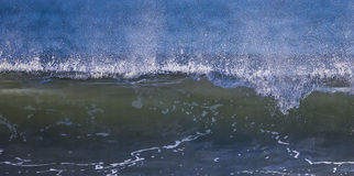 Waves. Breaking waves with spray and surf royalty free stock image