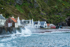 Waves breaking at spring tide in Pennan Royalty Free Stock Images