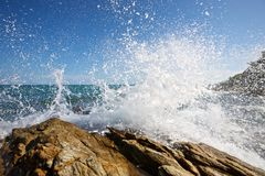 The waves breaking on a stony beach Stock Photos