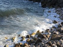 Waves breaking on a stony beach stock video footage