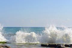 The waves breaking on a stony beach Stock Photos