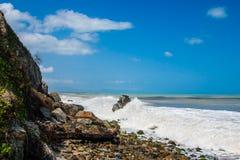 Waves breaking on a stony beach Stock Image