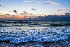 Waves breaking at sunset Royalty Free Stock Images