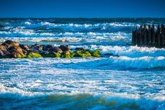 Waves breaking to stones Stock Photo