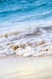 Waves breaking on tropical shore Stock Images