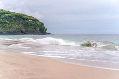 Waves breaking on a white sand Virgin beach on Bali. stock image