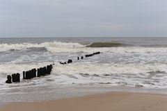 Waves and breakwaters on the shore of Baltic Sea in north of Poland in winter Stock Image