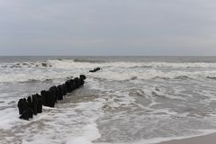 Waves and breakwaters on the shore of Baltic Sea in north of Poland in winter Stock Images
