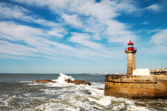 Waves on brekwater in Porto, Portugal. Royalty Free Stock Images