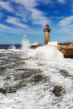Waves on brekwater in Porto, Portugal. Royalty Free Stock Photo