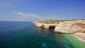 Waves of bright ocean near rocky coast Royalty Free Stock Photography